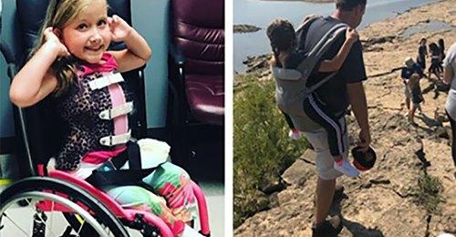 Lehrer trägt im Rollstuhl sitzende Schülerin (10), damit sie Schulausflug nicht verpasst